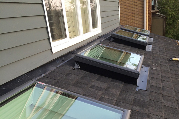 Tops Roofing Company Skylight installation